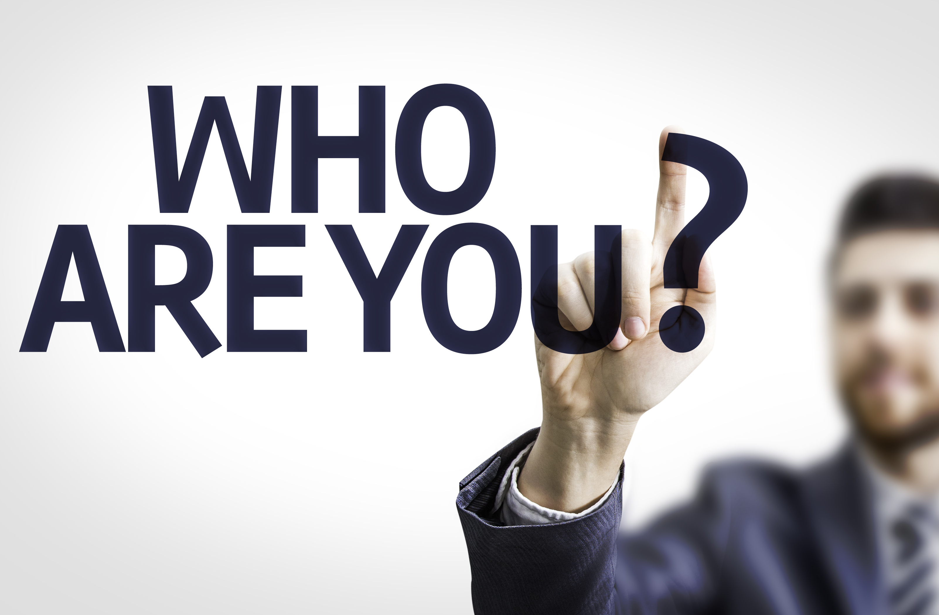 Business man pointing the text: Who are You?
